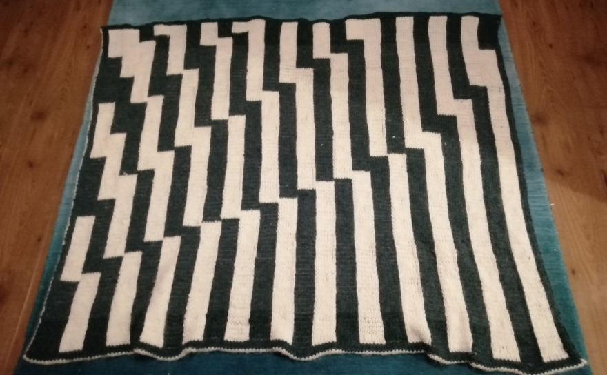 Knitted blanket in two colours with stripes